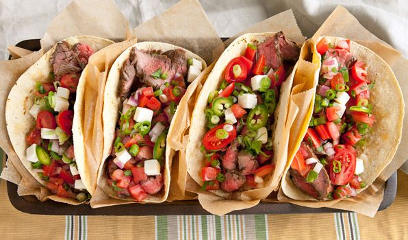Sweet & Spicy Steak Tacos | By: Stefano Faita | Marinated with beer, chipotles and honey, the steak for these tacos is tender, juicy and so flavourful! Using flank steak makes these tacos very budget friendly when serving a large crowd. | From: cbc.ca