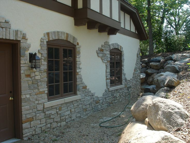 "STONE-STUCCO WALLS FEATURED IN THE ""MINNEAPOLIS TUDORS"" on garage"