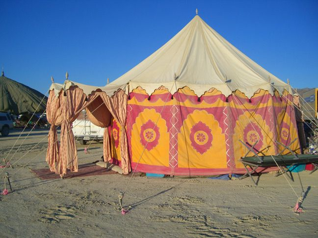 Moroccan paneling on the side of a yurt style tent.