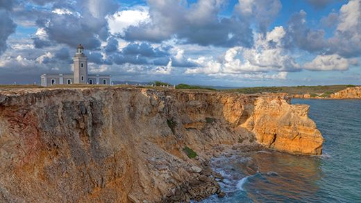 Los Morillos Lighthouse on the edge of a rugged cliff in Puerto Rico #traveling #caribbean #backpacking #kilroy