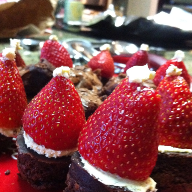 My mom and I made these sugar free brownies with strawberries to make Santa hats and a yummy treat for the holidays!