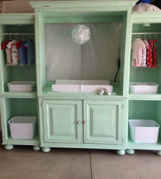 Old entertainment center converted into a baby changing station and storage.