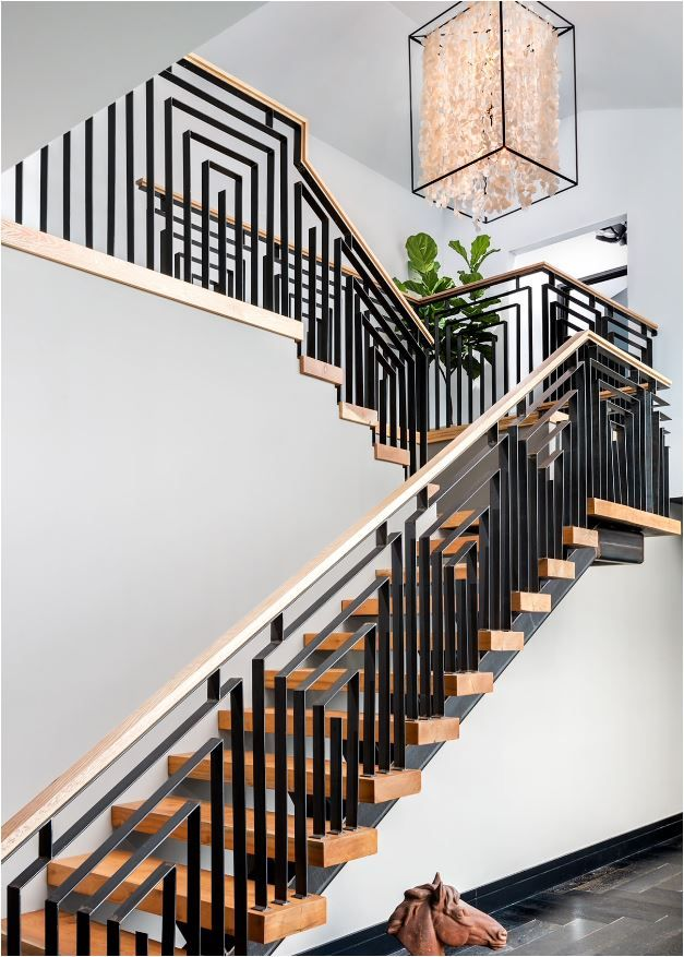 Beautiful design, but a little heavy.  Perhaps a thinner railing.  Stunning Stair Railings | Centsational Girl