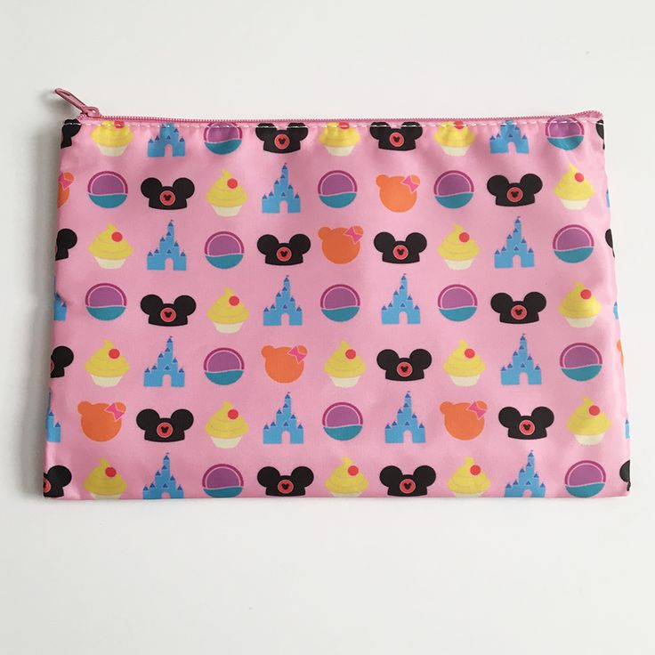 Here's a super cute pouch perfect for holding your buttons or cosmetics on your next trip.Pink pouch with Park Icons Print ​Bag is 6x9 inches and has a zipper closure. There is a small zippered pouch inside the bag as well, perfect for holding an ID or credit card.