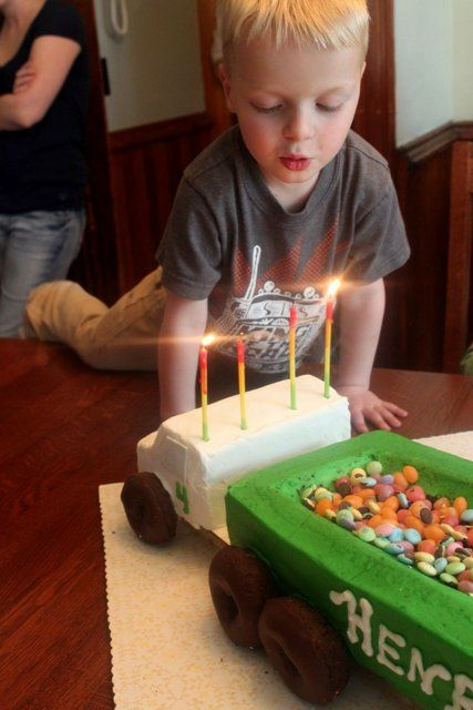 Henry's 4th Birthday Party -- semi truck cake  -- hauling semi loads of blocks to the 'river' along a tapes off road on the floor with tubs for grain bins to fill.