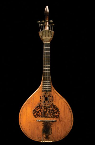 Lute. 18th century. Necked box-lute with tortoise shell guard and plectrum.