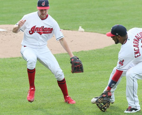 Cleveland Indians Edwin Encarnacion and Trevor Bauer go after a ground ball hit by the Oakland Athletics Matt Joyce, Joyce was out 3-4 (on appeal), in the 2nd inning at Progressive Field, Cleveland, Ohio, on May 30, 2017. (Chuck Crow/The Plain Dealer). Indians won 9-4