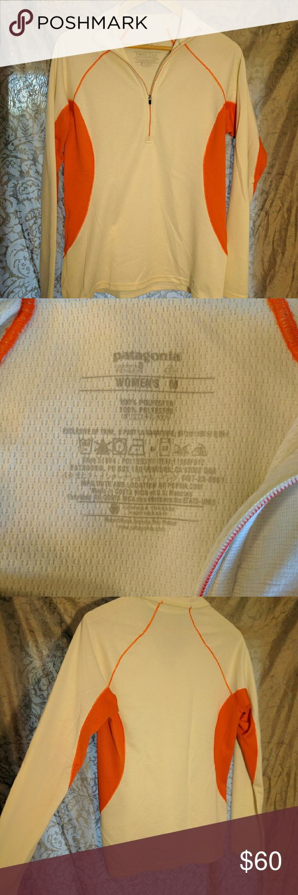 Patagonia under/mid layer pullover Orange and cream/white pullover. Worn once skiing with my ski coat over it. I bought two at the time and always preferred the other so this ones hardly been worn!! Durable quality garment from Patagonia (save $6 on v¡nted - find me with the same username) Patagonia Tops