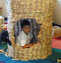 Boy in KAPLA basket