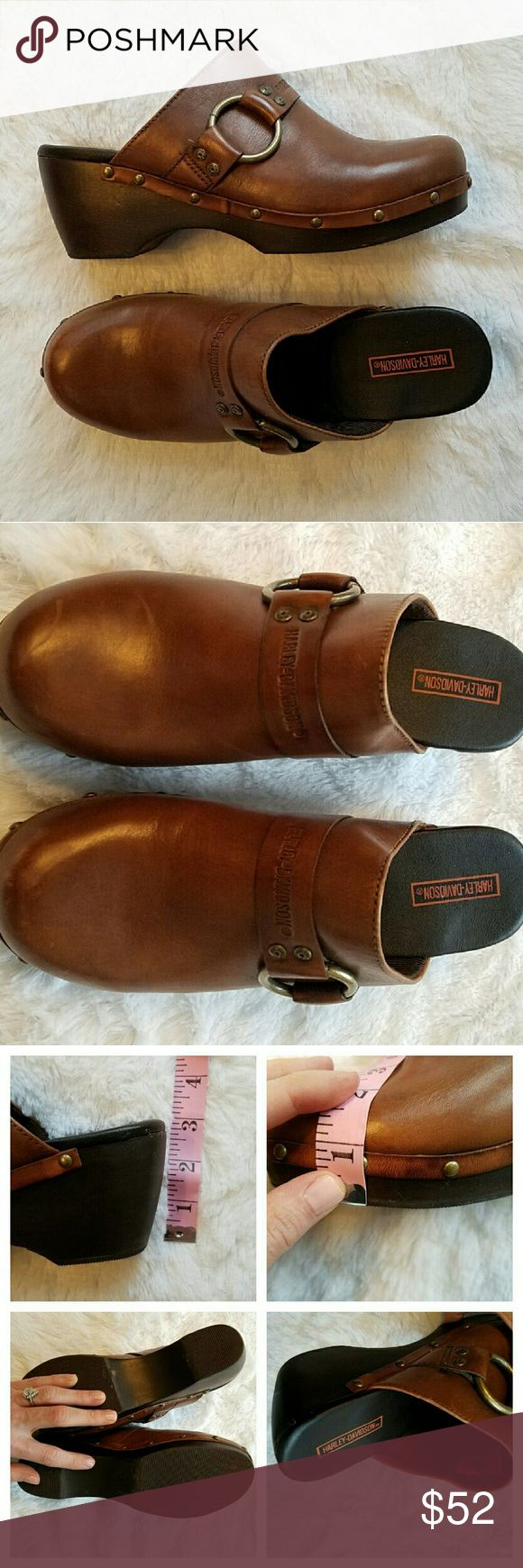 """{Harley Davidson} Leather Platform Mules Slip-on clogs by Harley-Davidson. EUC other than a couple light scuffs, pictured, which aren't noticeable unless you're a couple inches away.   Chocolatey brown, very soft leather. Insides look brand new with zero wear. Bottoms have a smidge of wear. Really beautiful shoes! 1"""" platform with 3"""" chunky heel. Very, very cozy. Cool gold hardware & studs. """"H.D. Motor Co."""" Stamped.   I offer 20% bundle discounts! Cheers! Harley-Davidson Shoes Mules & Clogs"""