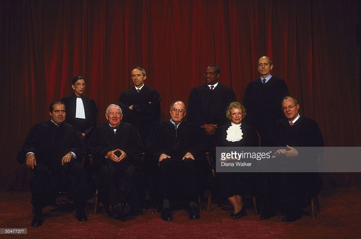 Supreme Court Justices (L-R) Scalia, Ginsburg, Stevens, Souter, Chief Rehnquist, Thomas, O'Connor, Breyer & Kennedy in formal portrait.