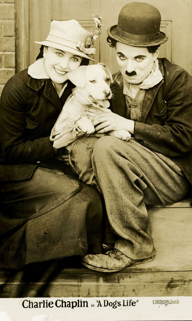 Charlie Chaplin with leading lady Edna Purviance and his co-star Scraps (real name Mut). ☀