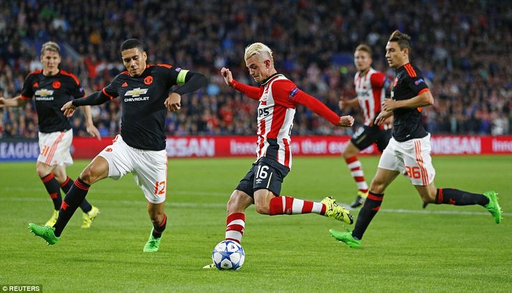 PSV's Belgian winger Maxime Lestienne, on loan from Qatari side Al-Arabi, shoots at goal as Chris Smalling sticks a boot out to block