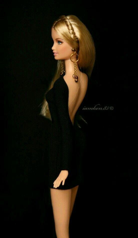 Interesting use of black background, black dress & lighting