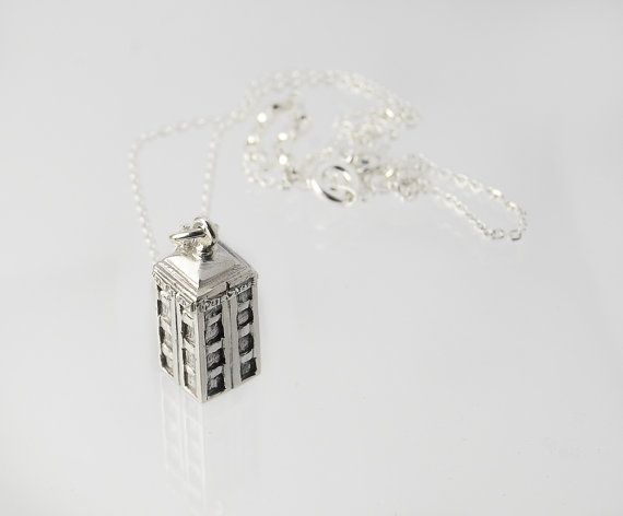 """Handmade silver pendant in shape of a Tardis inspired by the tv show Doctor  Who.  Comes with a silver anchor chain 40-45 cm long (with enlonging loops in the neck).  This is 925 sterling silver, 100% free from Nickel (Ni) so if you are nickel allergic you will not react to this.  The surface is treated with oxide for a """"greyish"""" look."""