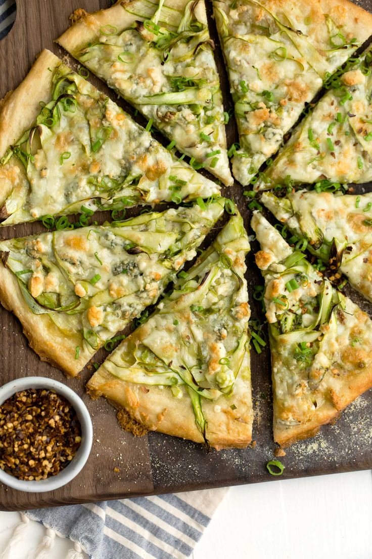 A delicious spring dinner, this asparagus pizza is made with shaved asparagus, olive oil, and just enough cheese to melt over the top.