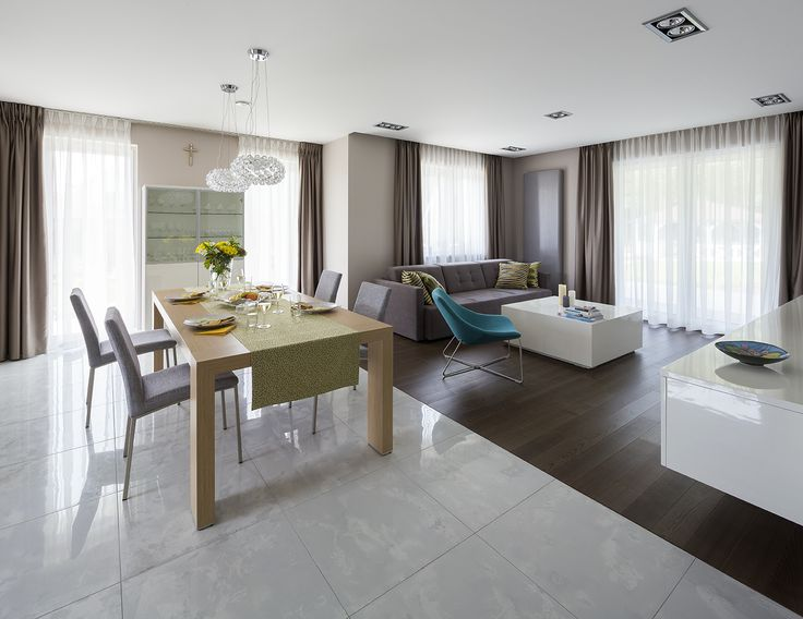 Colourful modern dining room, living room with dinning room, wood table, oak table, big table, Caboche lamp, turquoise armchair, white coffee table, grey living room