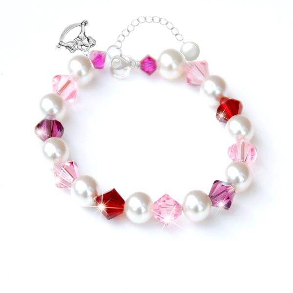 Adorabelle Pearl & Crystal Bracelet - Make your little girl feel like a princess with this beautiful unique sparkling bracelet. Add one of our enchanting charms and make this the perfect gift for baby's 1st Christmas.  Lustrous 6mm crystal white Swarovski pearl adorned with radiant 6mm Swarovski crystal bicones in shades of vintage rose, siam red and deep amethyst. Finished with a sterling silver clasp and extension chain at the end of which dangles a dainty pearl drop.