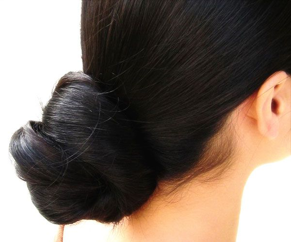 Long Hair Bun  Very long hair rolled to form a low bun and secured with a barrette that gives a cool look