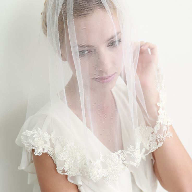 STYLE - #321 CODE:VEI006 Floral lace trimmed veil.   Angelic blusher features soft vridal illustion tulle with heavily beaded lace trim.  The veil can be worn as a blusher or towards the back as a simple veil. To order yours contact us at loca@localoca.co.za www.localoca.co.za