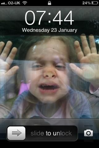 1) Get your child to squash up against a window 2) Take photo 3) Set as phone background 4) Child is 'stuck in' phone.  Adorable and only slightly horrifying