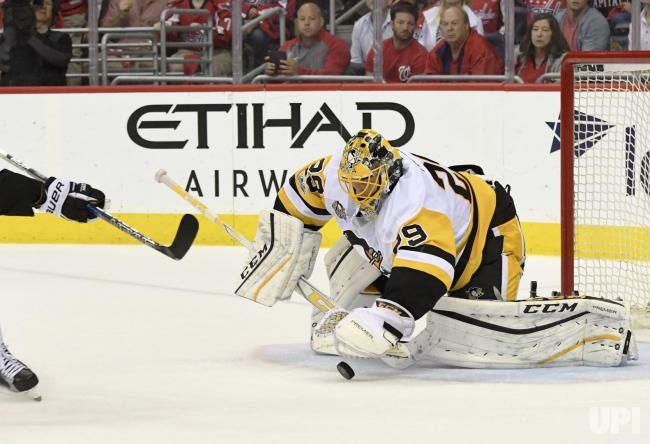 Pittsburgh Penguins goalie Marc-Andre Fleury (29) dives for a first period save on a shot by the Washington Capitals at the Verizon Center…