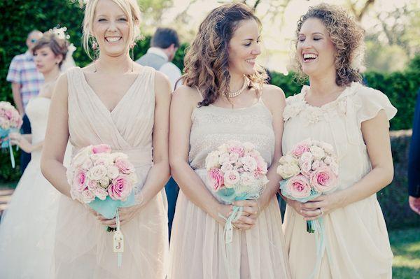 Happy bridesmaids in cream-colored summer cocktail dresses at wedding - Wedding Photo by Elizabeth Davis