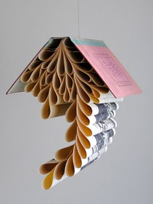 """15 mobiles you can DIY or buy  """"Word nerd """" Aspiring mobile-makers can breathe new life into old books with this DIY hanging sculpture from the ShopHouse Etsy shop. All you need is two hands and a penchant for folding paper to create stunning works of original art."""