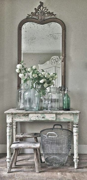 Group vintage table, mirror, old bottles, baskets and add fresh flowers for lovely display.  Nice way to use odd pieces stored away or show case a small collection of depression glass!