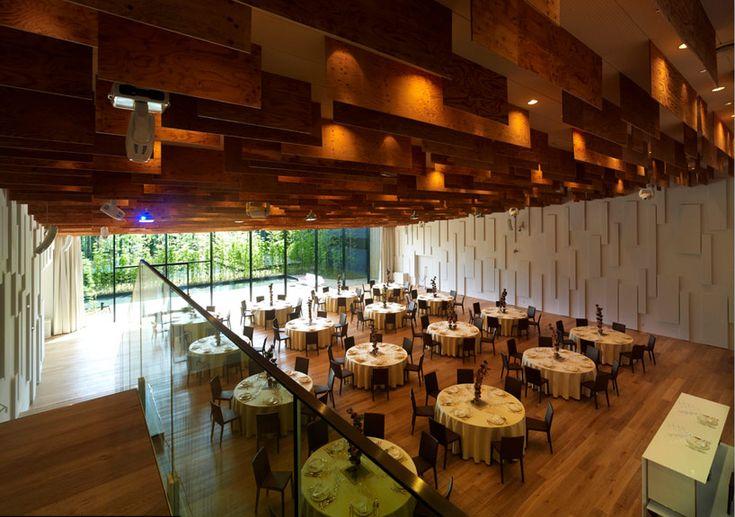 kengo kuma garden terrace miyazaki banquet hall - textured wall and wooden acoustical baffles on ceiling create a calming environment.