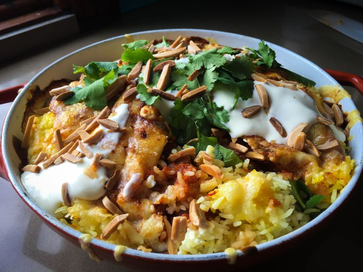 Mexican saffron rice with chilli tomato sauce, creamy bajar sauce, grated cheddar, toasted almonds & coriander