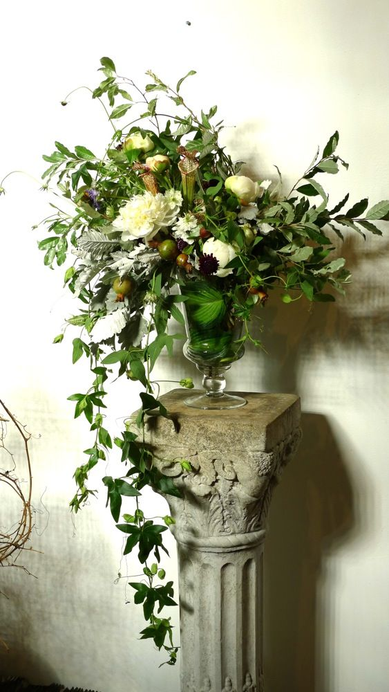 I like the relaxed, informal look and glass vase against the worn stone - for an arrangement near the pulpit?
