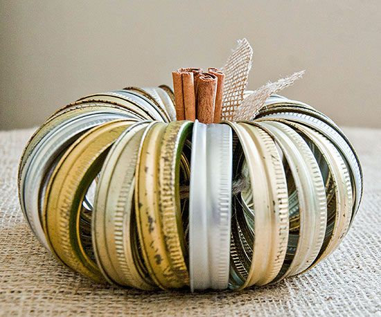 Need a classy addition to a fall tabletop vignette? This simple DIY pumpkin fills the bill beautifully. Just bundle silver and gold canning jar rings into a miniature pumpkin, tying the rings snugly with string. Then snip burlap leaves and tuck them around a cinnamon-stick stem for a pretty, subtly fragrant finish. Buy new canning rings for this project or use old ones from your canning stash -- a little tarnish just adds charm!/