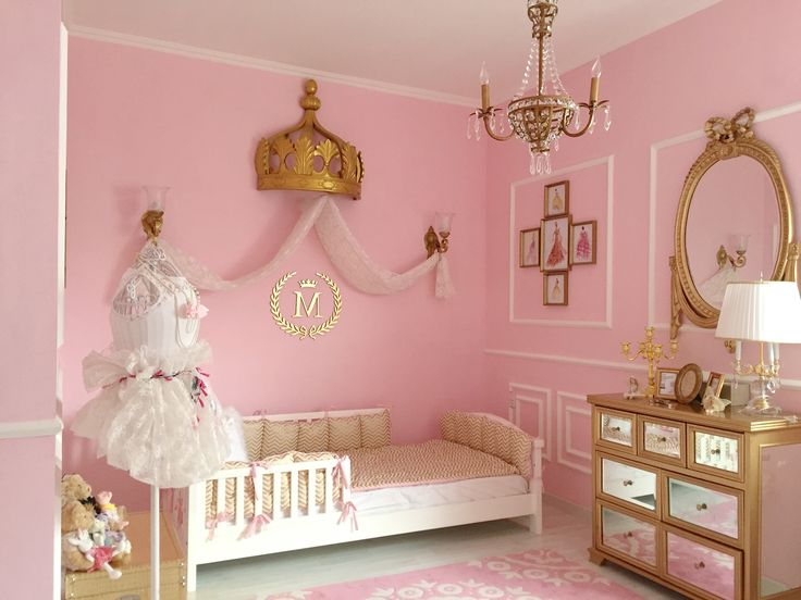 A pink and gold, sweet and classic Parisian Nursery featuring many custom made items.