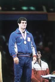 Levi's did the best parade and podium outfits our U.S. Olympians ever had!  Wrestler Mark Schultz on the podium for his Los Angeles 1984 gold medal.