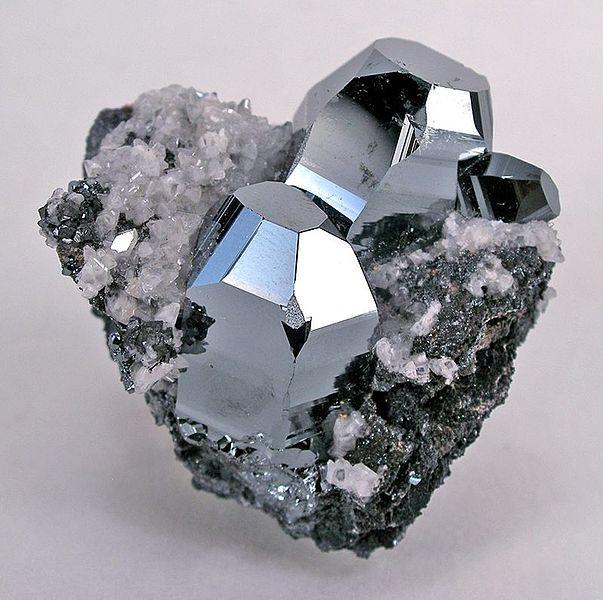 Calcite, Hematite.  Locality: Wessels Mine (Wessel's Mine), Hotazel, Kalahari manganese fields, Northern Cape Province, South Africa.  Size: miniature, 4.1 x 3.7 x 3.2 cm