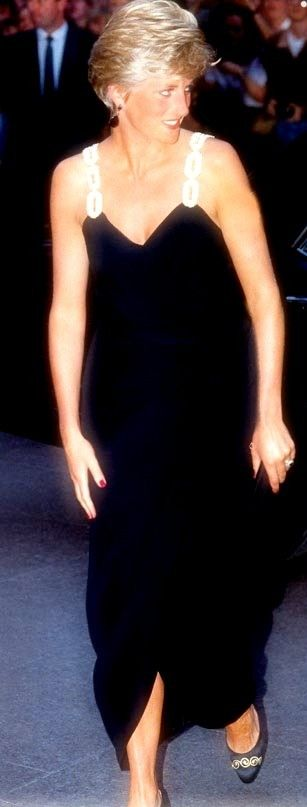 Diana first wore this black gown with gold straps  in October 1987. She wore it again in Canada in 1991, and to attend a gala of the Kirov Ballet at the London Coliseum in July 1993.