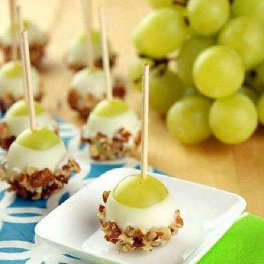 """Grape Popperz"" ~ use cherries, strawberries, etc. Ingredients: 48 fresh grapes Vanilla Greek yogurt(or desired yogurt flavor) 1 cup chopped pecans (may substitute with any nuts) toothpicks Instructions Wash grapes and pat completely dry. Spear each grape with a toothpick. ~ Hold toothpick, dip grape in the vanilla Greek yogurt ; allow excess coating to drip off. ~ Dip end of the grape chopped pecans; place on wax paper to dry."