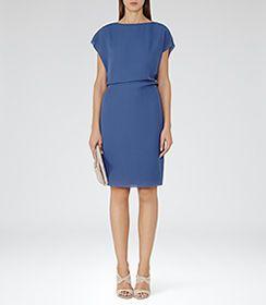 Blue dress in spanish kicking
