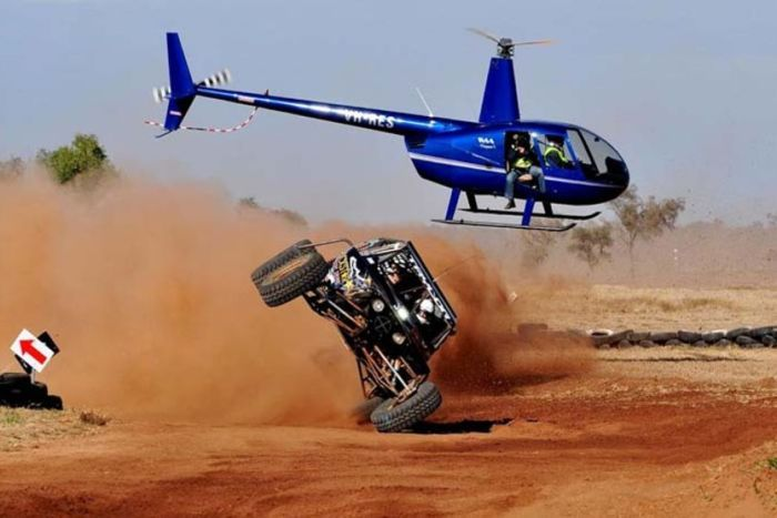 A competitor in the Finke Desert Race takes a bend on two wheels