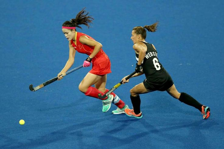 RIO DE JANEIRO, BRAZIL - AUGUST 13: Petrea Webster of New Zealand and Qiuxia Cui of China compete for the ball in the Women's Pool A match between the People's Republic of China and New Zealand on Day 8 of the Rio 2016 Olympic Games at the Olympic Hockey Centre on August 13, 2016 in Rio de Janeiro, Brazil. (Photo by Phil Walter/Getty Images) — in Rio de Janeiro, Brazil.
