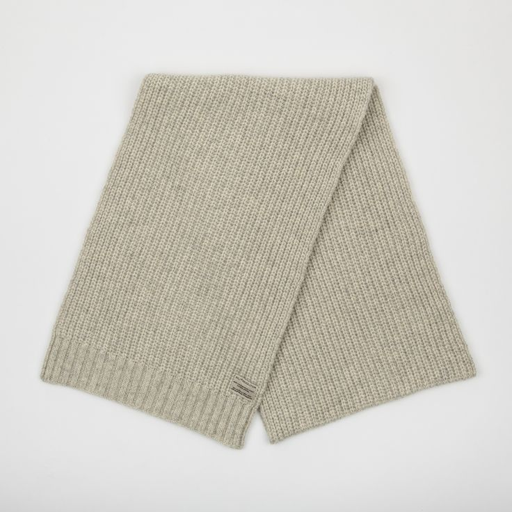 Offwhite: Heavy wool blend scarf with knitted pattern to add detail, has til RVLT brand label.