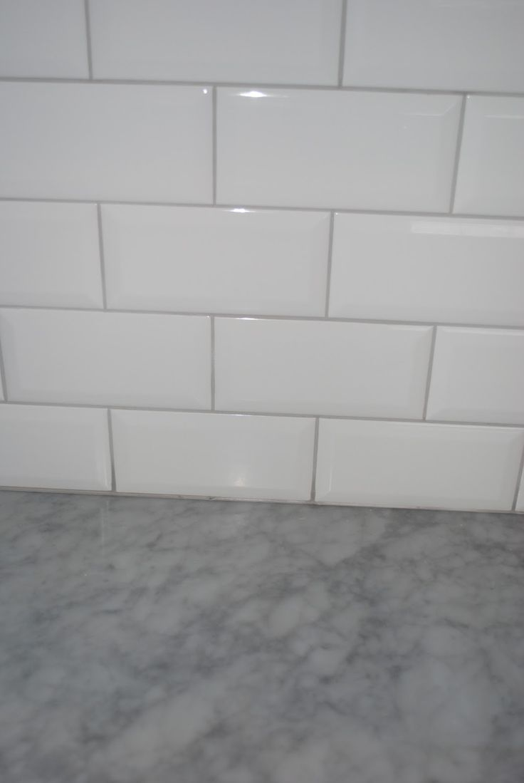 White Subway Tile With Grey Grout Countertop