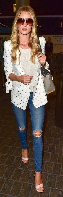 Rosie Huntington-Whiteley, diamond jewelry, gray handbag, white print blazer, ripped skinny jeans, and nude sandals