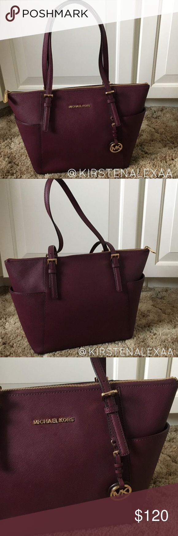 "Michael Kors Purple Tote Bag This bag is in excellent used condition! it is a purple brownish color. Side pockets, inside pockets, zipper compartment, and keychain clasp. Slight wear on bottom studs shown in fourth picture. Dimensions: 15"" x 10"" Michael Kors Bags Totes"