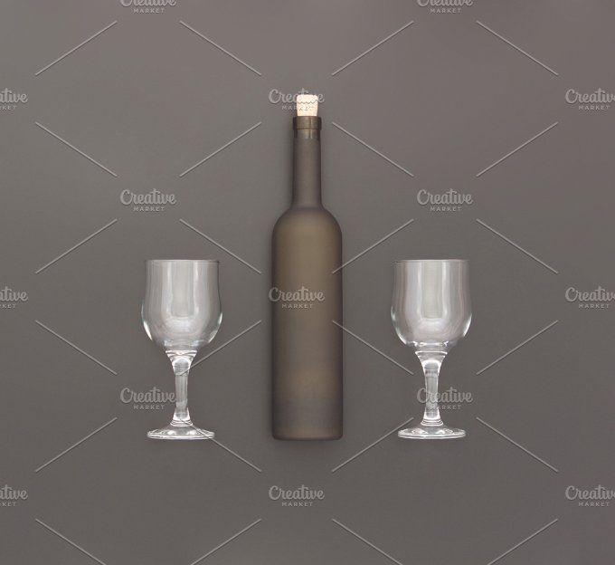 Bottle of wine and two glasses. by Milla Mi on @creativemarket