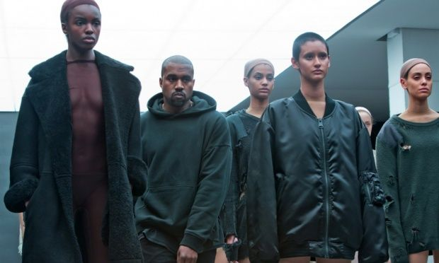 Kanye West with models during the  showing of the Kanye West Adidas Fall 2015 collection, Kanye West debuts fashion line – and new song at New York fashion week