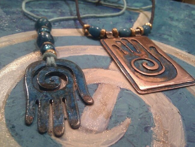 Hopi hands, copper with patina, varnished with turquoise glass beads.2015 ebm This design is based on the hopi hand. I do not have a connection with native american culture, but i borrowed this sign because for me as a Reiki master practitioner this hand symbolises the healing power that is transferred from my hands to the one I am treating.