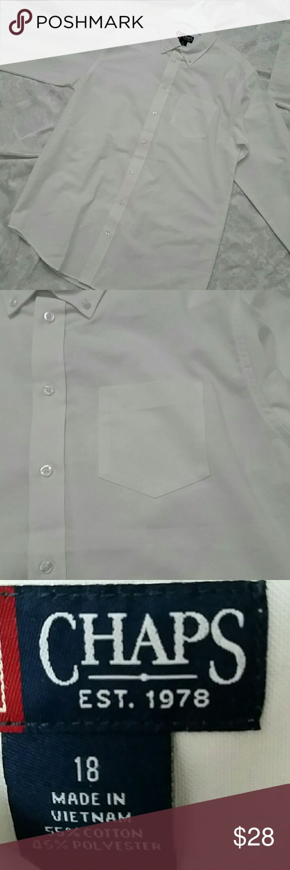 Chaps boys white long button down shirt size 18 White Chaps long sleeve, white button down shirt, brand new with tags. Never worn. Perfect condition! Measures 28 inches shoulder to bottom hem, 20 inches armpit to armpit, 23 inches sleeve. BOYS Chaps Shirts & Tops Button Down Shirts