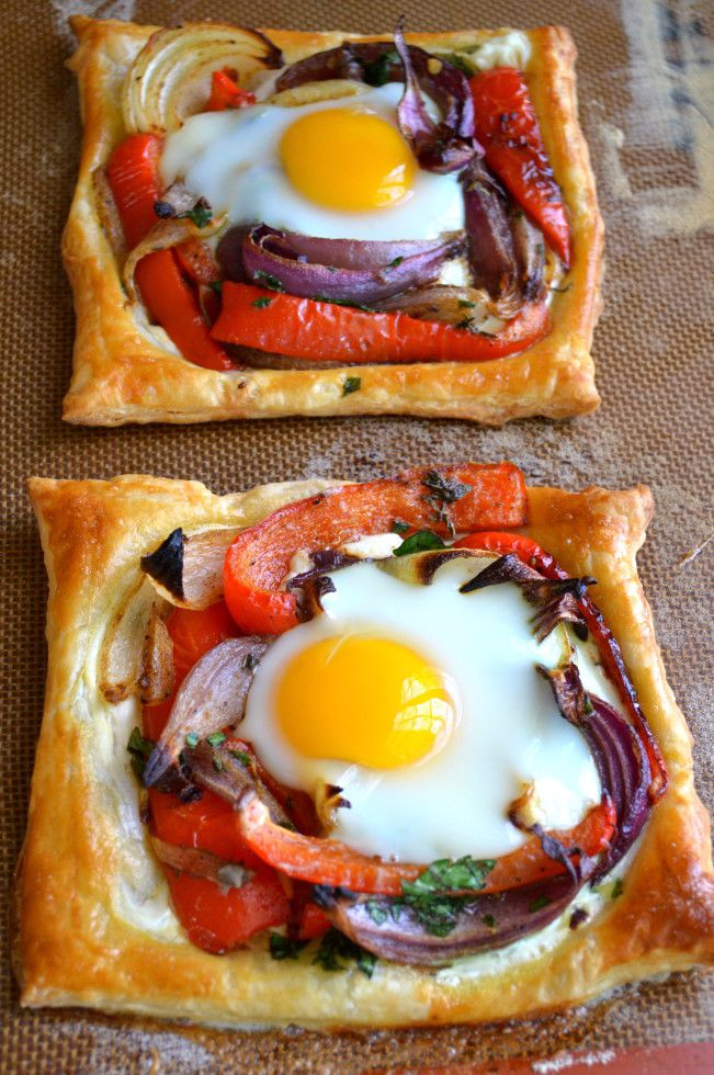 "Red Pepper and Baked Egg Galettes is a grown up version of ""toad in a hole"" using a puff pastry sheet, smeared with a bit of sour cream, topped with roasted red peppers and red onions (oh my!) and a fresh egg plopped on top. Great for a brunch dish"
